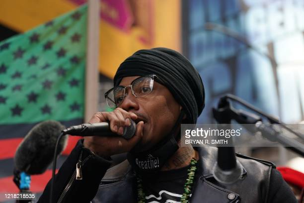 US actor Nick Cannon speaks during a Black Lives Matter protest in Times Square over the death of George Floyd by a Minneapolis police officer on...