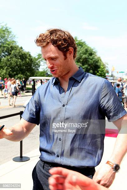 Actor Nick Gehlfuss from NBC's 'Chicago Med' greets fans outside the Indianapolis Central Library during the Indianapolis 500 Festival Parade in...
