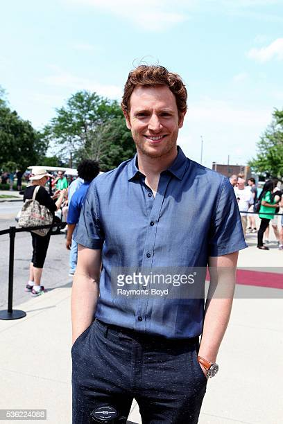 Actor Nick Gehlfuss from NBC's 'Chicago Med' poses for photos outside the Indianapolis Central Library during the Indianapolis 500 Festival Parade in...