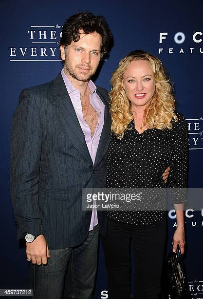 Actor Nick Holmes and actress Virginia Madsen attend the premiere of The Theory of Everything at AMPAS Samuel Goldwyn Theater on October 28 2014 in...