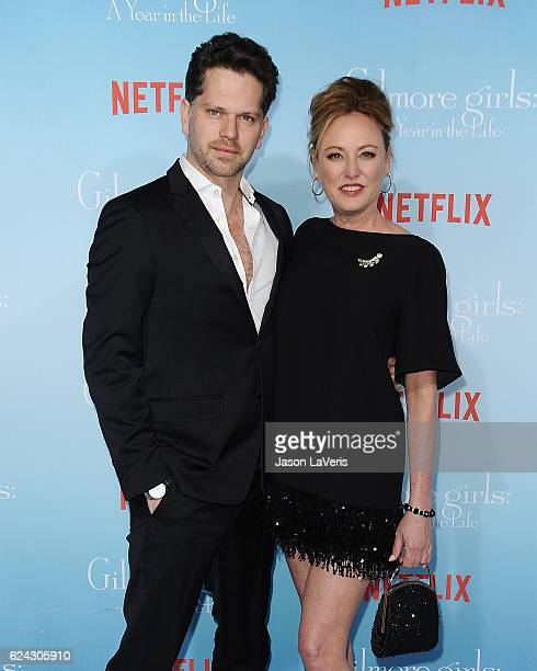 Actor Nick Holmes and actress Virginia Madsen attend the premiere of 'Gilmore Girls A Year in the Life' at Regency Bruin Theatre on November 18 2016...