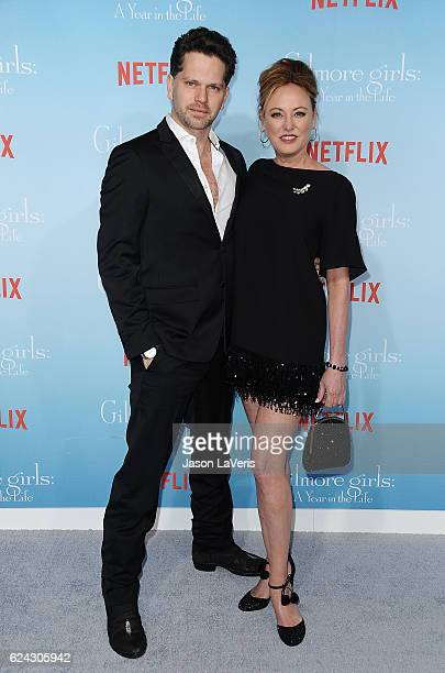 Actor Nick Holmes and actress Virginia Madsen attend the premiere of Gilmore Girls A Year in the Life at Regency Bruin Theatre on November 18 2016 in...