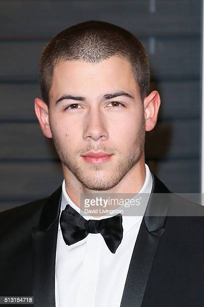Actor Nick Jonas arrives at the 2016 Vanity Fair Oscar Party Hosted by Graydon Carter at the Wallis Annenberg Center for the Performing Arts on...