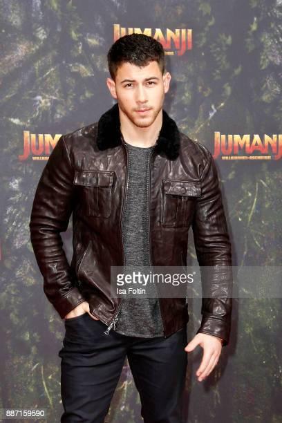US actor Nick Jonas attends the German premiere of 'Jumanji Willkommen im Dschungel' at Sony Centre on December 6 2017 in Berlin Germany