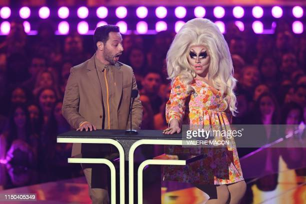 TOPSHOT US actor Nick Kroll and US drag queen Trixie Mattel speak onstage during the 2019 MTV Movie TV Awards at the Barker Hangar in Santa Monica on...
