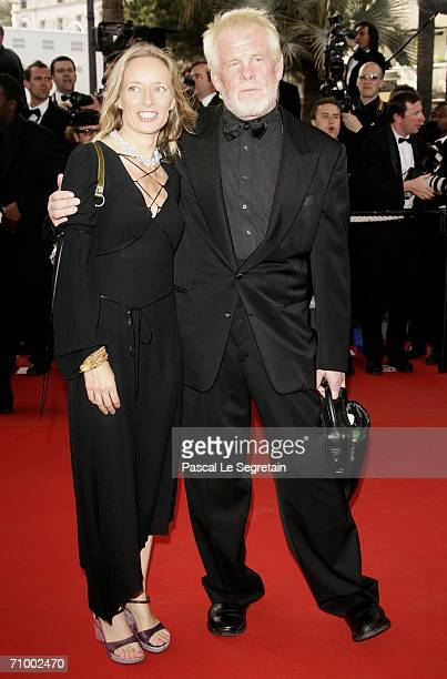US actor Nick Nolte and guest attend the 'Over The Hedge' premiere at the Palais during the 59th International Cannes Film Festival May 21 2006 in...