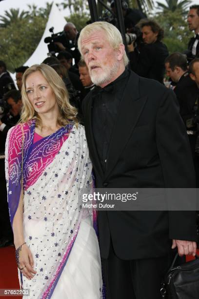 Actor Nick Nolte and guest attend the Paris Je T'aime premiere during the 59th International Cannes Film Festival May 18 2006 in Cannes France