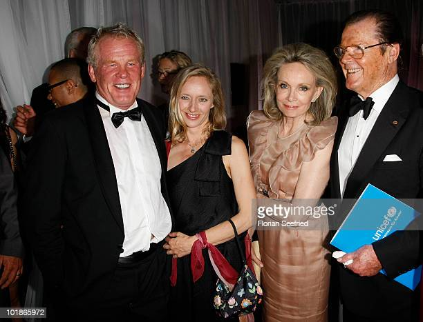 Actor Nick Nolte Clytie Lane actor Roger Moore and partner Kiki Tholstrup attend An Evening For Africa at the Burda Medien Park on June 7 2010 in...