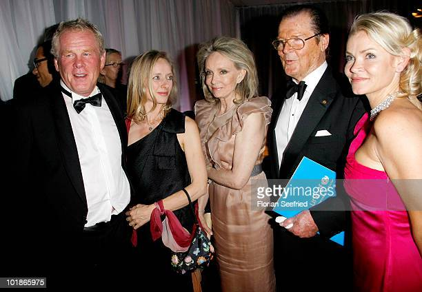 Actor Nick Nolte Clytie Lane actor Roger Moore and partner Kiki Tholstrup and her daughter Christina Knudsen attend An Evening For Africa at the...