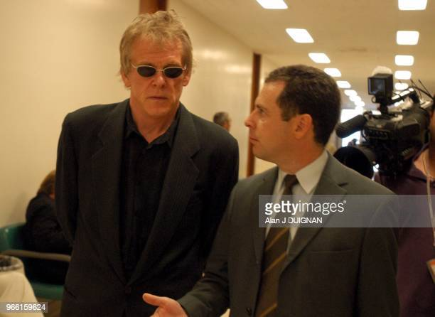 Actor Nick Nolte left and his attorney Mark Worksman walk down the hallway after after his progress report hearing before Judge Lawrence Mira at...