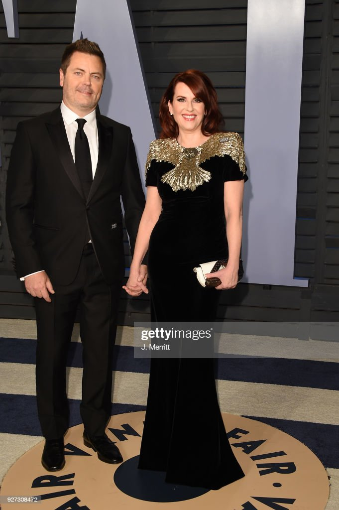 Actor Nick Offerman (L) and actress Megan Mullally attend the 2018 Vanity Fair Oscar Party hosted by Radhika Jones at the Wallis Annenberg Center for the Performing Arts on March 4, 2018 in Beverly Hills, California.