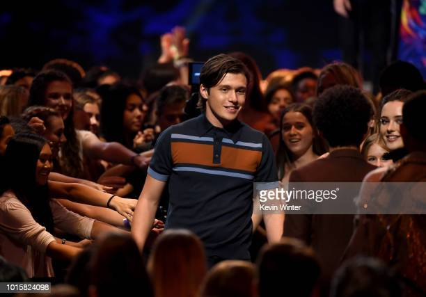 "Actor Nick Robinson accepts the Choice Comedy Movie for ""Love, Simon"" onstage during FOX's Teen Choice Awards at The Forum on August 12, 2018 in..."