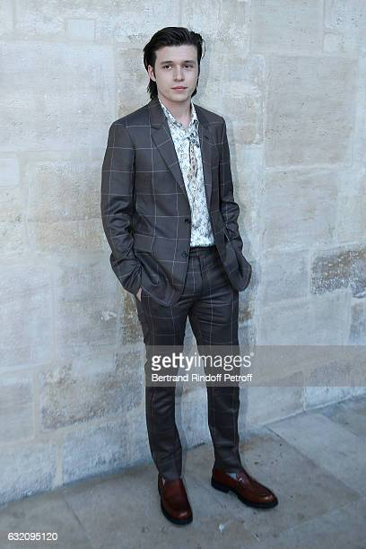 Actor Nick Robinson attends the Louis Vuitton Menswear Fall/Winter 20172018 show as part of Paris Fashion Week Held at Palais Royal on January 19...