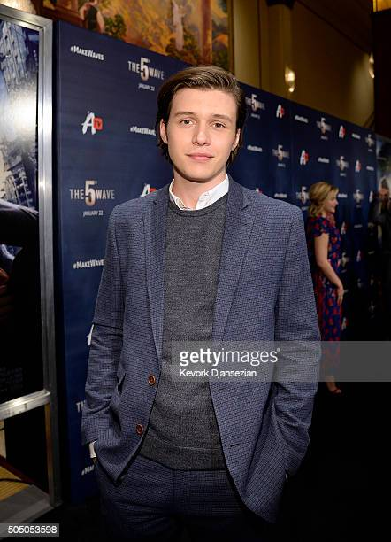 Actor Nick Robinson poses during the AwesomenessTV special fan screening of The 5th Wave at Pacific Theatre at The Grove January 14 2016 in Los...