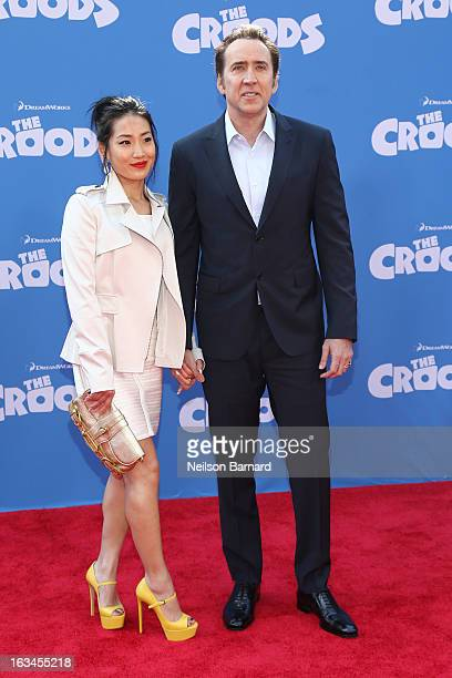 Actor Nicolas Cage and Alice Kim attend The Croods premiere at AMC Loews Lincoln Square 13 theater on March 10 2013 in New York City