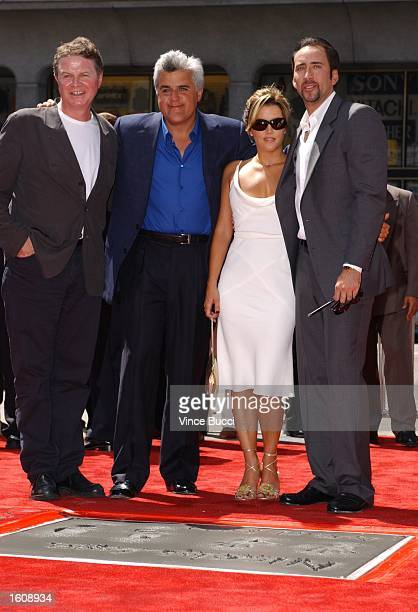 Actor Nicolas Cage and girlfriend actress Lisa Marie Presley pose with director John Madden and comedian Jay Leno after a hand and footprint ceremony...
