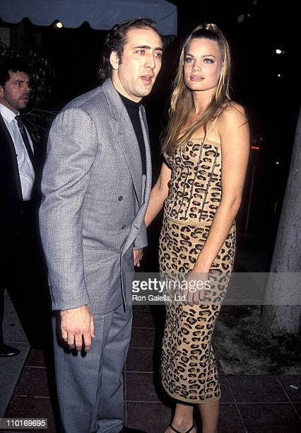 Actor Nicolas Cage and girlfriend Kristen Zang attend A Few Good Men Westwood Premiere on December 9 1992 at Mann Village Theatre in Westwood...