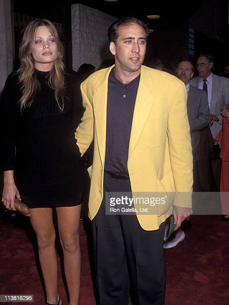 Actor Nicolas Cage and girlfriend Kristen Zang attend the Much Ado About Nothing Westwood Premiere on May 10 1993 at Mann National Theatre in...