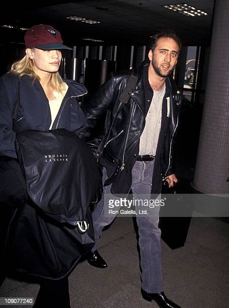 Actor Nicolas Cage and girlfriend Kristen Zang depart for New York City on January 2 1994 at Los Angeles International Airport in Los Angeles...