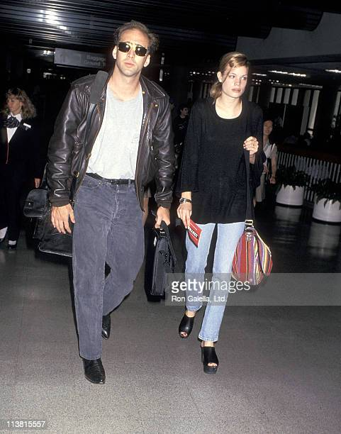 Actor Nicolas Cage and girlfriend Kristen Zang on July 28 1993 arrive at the Los Angeles International Airport in Los Angeles California
