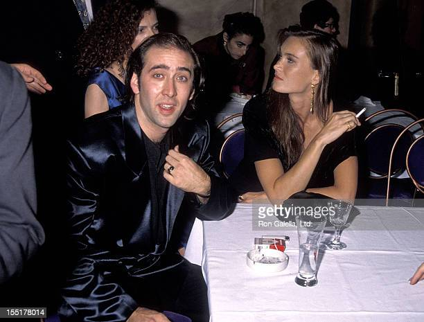Actor Nicolas Cage and girlfriend Lisa Stothard attend the Wild at Heart Premiere Party on August 13 1990 at Arena in Hollywood California