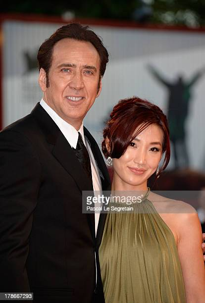 Actor Nicolas Cage and his wife Alice Kim Cage attend the 'Joe' Premiere during The 70th Venice International Film Festival at Palazzo Del Cinema on...