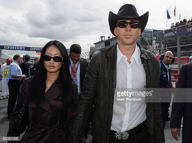 Actor Nicolas Cage and his wife Alice Kim walk the grid before the Australian Formula One Grand Prix at Albert Park on March 6 2005 in Melbourne...