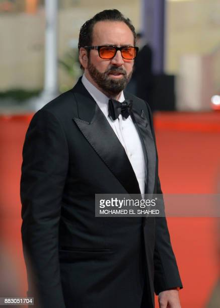 US actor Nicolas Cage arrives on the red carpet to attend the closing ceremony of the 39th edition of the Cairo International Film Festival in the...