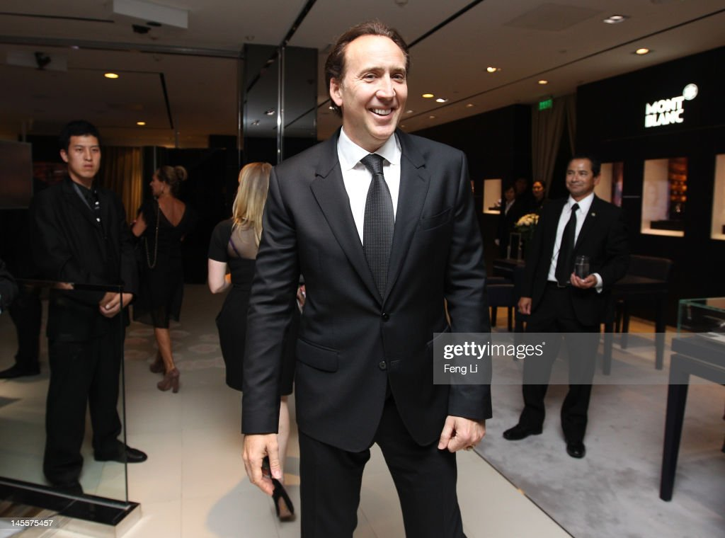 Actor Nicolas Cage (C) attends the Montblanc international gala to celebrate the official opening of its new and biggest concept store in the world at the Montblanc Sanlitun Concept Store on June 1, 2012 in Beijing, China.