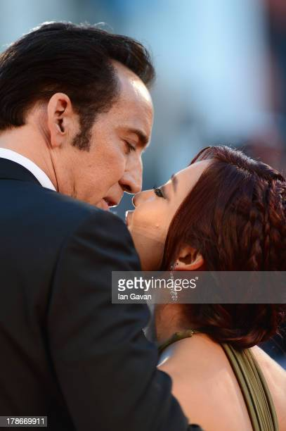 Actor Nicolas Cage kisses his wife Alice Kim Cage at the 'Joe' Premiere during The 70th Venice International Film Festival at Palazzo Del Cinema on...