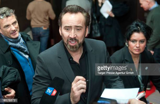 Actor Nicolas Cage signs autographs after 'The Croods' Press Conference during the 63rd Berlinale International Film Festival on February 15 2013 in...