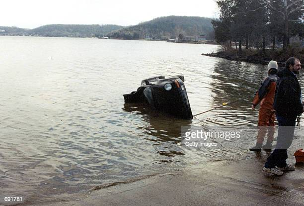 Actor Nicolas Cages 1989 Porsche Sportster is pulled from the Lake of the Ozarks MO January 16 2002 The $100000 collectors item was in transport from...