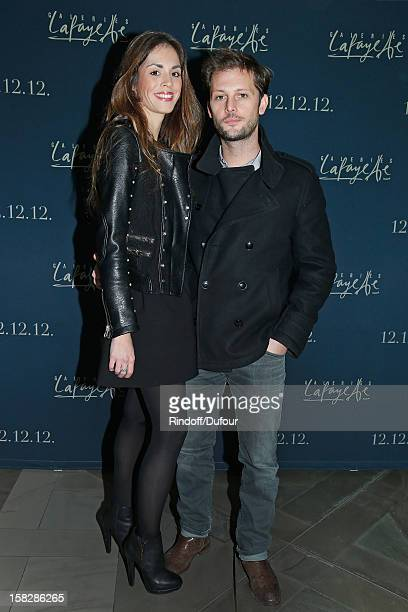 Actor Nicolas Duvauchelle and Laura Isaaz attend the Galeries Lafayette 100th Anniversary Bal on December 12 2012 in Paris France