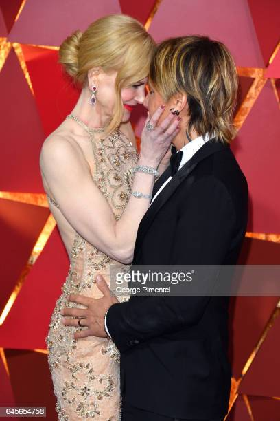 Actor Nicole Kidman and singer Keith Urban kiss at the 89th Annual Academy Awards at Hollywood Highland Center on February 26 2017 in Hollywood...