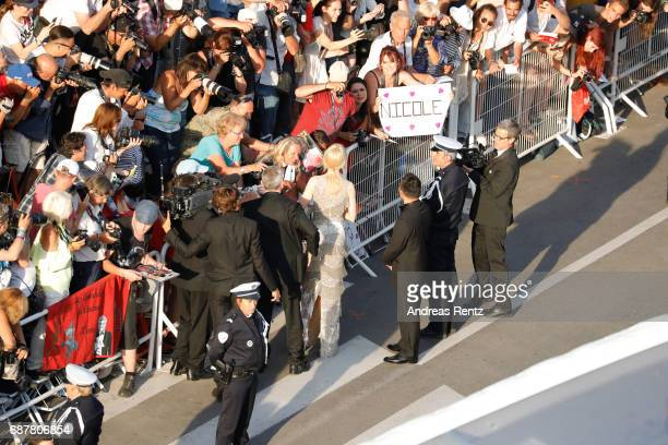 Actor Nicole Kidman greets fans at the 'The Beguiled' screening during the 70th annual Cannes Film Festival at Palais des Festivals on May 24 2017 in...