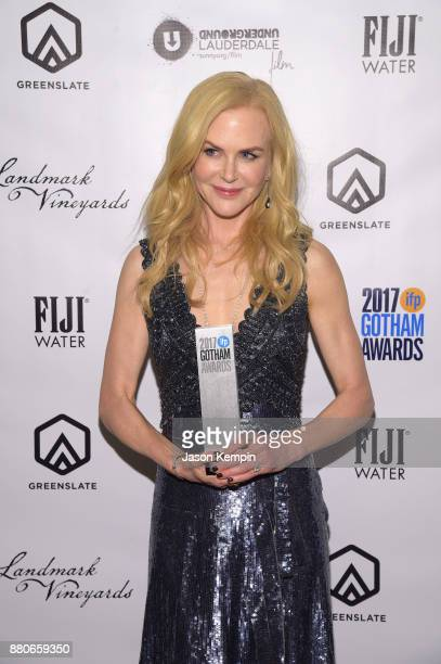 Actor Nicole Kidman poses with the Gotham Tribute Award in the GreenSlate Greenroom at The 2017 Gotham Awards at Cipriani Wall Street on November 27...