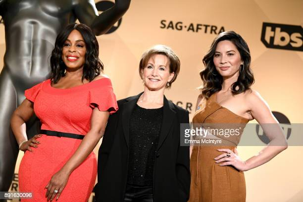 Actor Niecy Nash SAGAFTRA President Gabrielle Carteris and actor Olivia Munn at the 24th Annual Screen Actors Guild Awards Nominations Announcement...