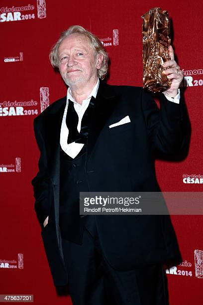 Actor Niels Arestrup, winner of the Best Supporting Actor award, poses in the awards room during the 39th Cesar Film Awards 2014 at Theatre du...