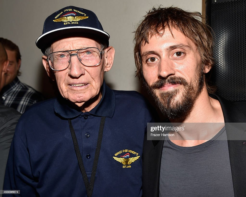Actor Niko Nicotera poses with a U.S. Armed Forces Veteran ...