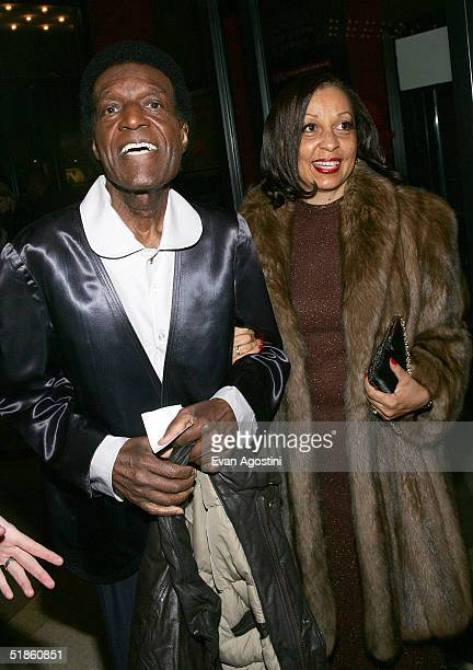 Actor Nipsey Russell and his guest attend The Aviator film premiere on December 14 2004 at the Zeigfeld Theatre in New York City