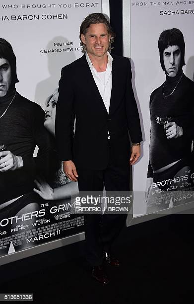 Actor Noah Huntley poses on arrival for the premiere of the film 'The Brothers Grimsby' in Los Angeles California on March 3 2016 / AFP / FREDERIC J...