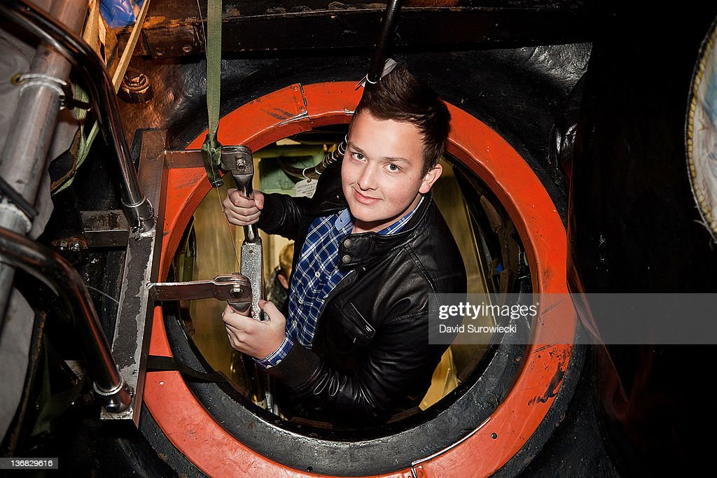 Actor Noah Munck enters the submarine USS Hartford at Naval Submarine Base New London on January 11, 2012 in Groton, Connecticut. Munck and the cast of iCarly were presenting a special military family screening of iMeet The First Lady, an episode of their show featuring Michelle Obama.