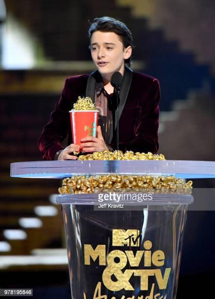 Actor Noah Schnapp accepts award onstage at the 2018 MTV Movie And TV Awards at Barker Hangar on June 16 2018 in Santa Monica California