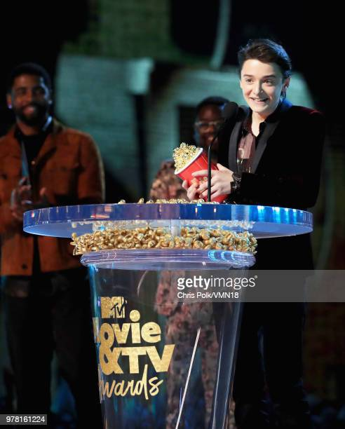 Actor Noah Schnapp accepts the Best Show award for 'Stranger Things' onstage during the 2018 MTV Movie And TV Awards at Barker Hangar on June 16 2018...