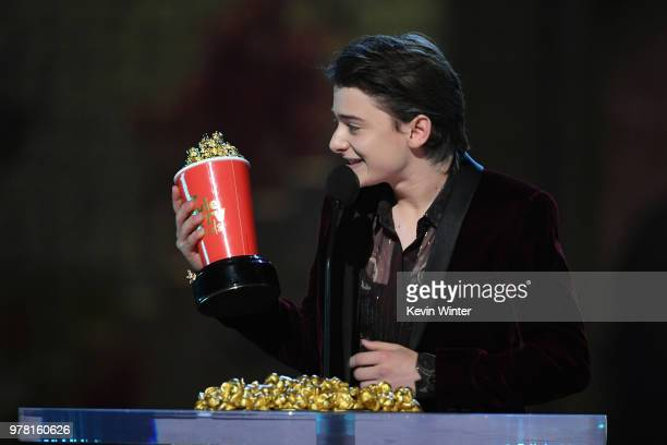 Actor Noah Schnapp accepts the Most Frightened Performance award for 'Stranger Things' onstage during the 2018 MTV Movie And TV Awards at Barker...