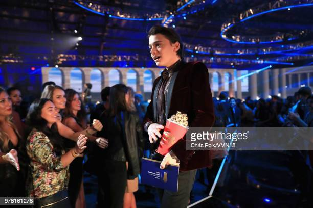 Actor Noah Schnapp accepts the Most Frightened Performance award for 'Stranger Things' at the 2018 MTV Movie And TV Awards at Barker Hangar on June...