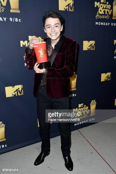 Actor Noah Schnapp poses with the Best Show award for 'Stranger Things' at the 2018 MTV Movie And TV Awards at Barker Hangar on June 16 2018 in Santa...