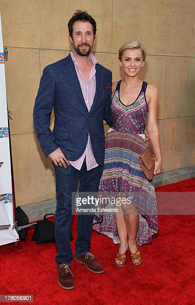 Actor Noah Wyle and actress Sara Wells arrive at the premiere of Snake Mongoo$e at the Egyptian Theatre on August 26 2013 in Hollywood California