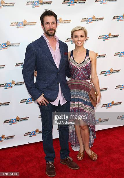 """Actor Noah Wyle and Sara Wells attends the premiere of """"Snake & Mongoo$e"""" at the Egyptian Theatre on August 26, 2013 in Hollywood, California."""
