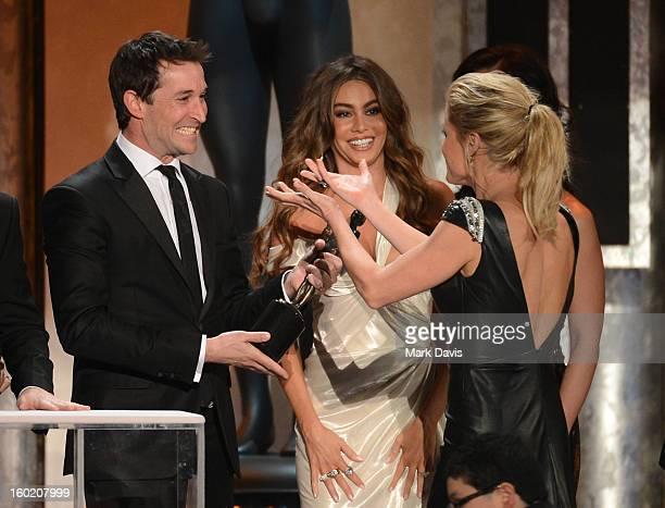 Actor Noah Wyle presents the award for Outstanding Performance by an Ensemble in a Comedy Series to actors Sofía Vergara and Julie Bowen for 'Modern...